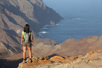 Woman hiking on top volcanic craters on St Helena