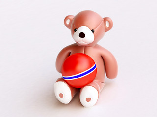Teddy Bear with Red Ball on Knees
