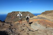 Couple hiking on top volcanic craters on St Helena