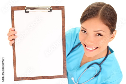 Nurse / doctor showing blank clipboard sign