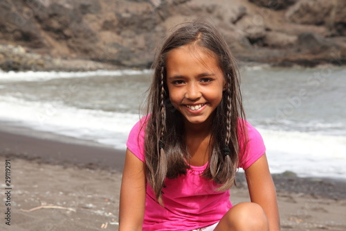 Pretty young girl enjoying day on beach from Darrin Henry, Royalty ...