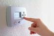 Leinwandbild Motiv thermostat and human hand