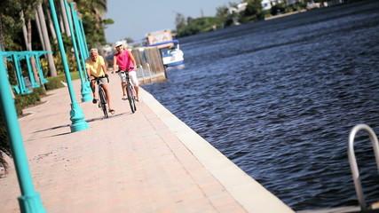 Active Seniors Cycling Along Waterways
