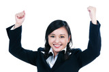 Happy young businesswoman with her arms raised