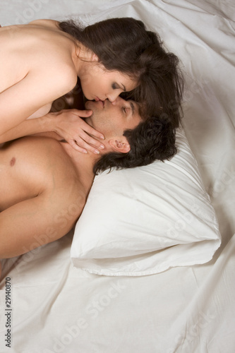 Young naked Man and woman making love in bed