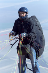 The glider pilot prepares for flight on a paraplane