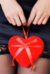 Sexy woman in  miniskirt and stockings - Valentine's Day