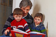 father reading a childrens book to his sons 04