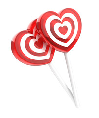Two lollipops heart shaped isolated on white