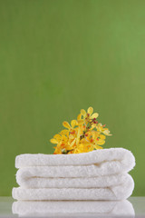 yellow orchid on towel