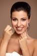 Portrait of a beautiful woman flossing teeth