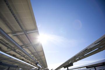 Solar Panels from underneath, sun flare