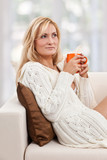 Beauty, blondie woman in a sofa