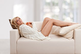Beauty, blondie woman laying in a sofa