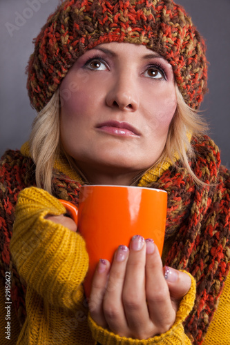 Beauty, blondie woman with an orange-colored cup