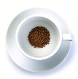 granules of instant coffee in cup poster