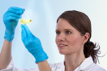 Female caucasian biotechnician in the lab