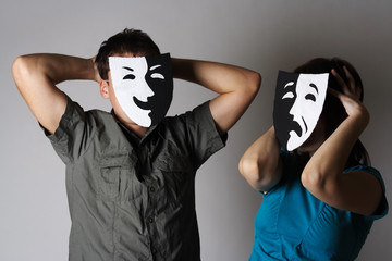 man and woman in theater black and white emotions masks, half bo