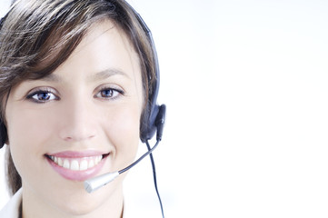 young woman in job; headphones and customer service