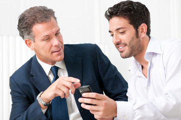 Business discussion with mobile phone