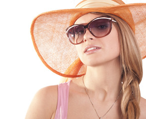 Portrait girl in hat looking through sunglasses