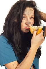 Portrait of beggar girl eat bread