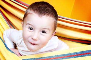 Little boy having fun in hammock