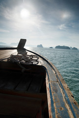 Wooden boat heading islands