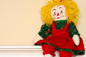 Rag doll sitting on ledge
