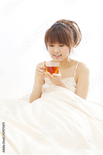 a portrait of beautiful asian woman on the bed