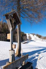 Bildstock mit Winterlandschaft in den bayrischen Voralpen