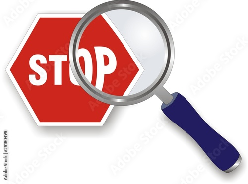 srop sign under magnifying glass