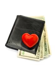 heart on currency in black wallet