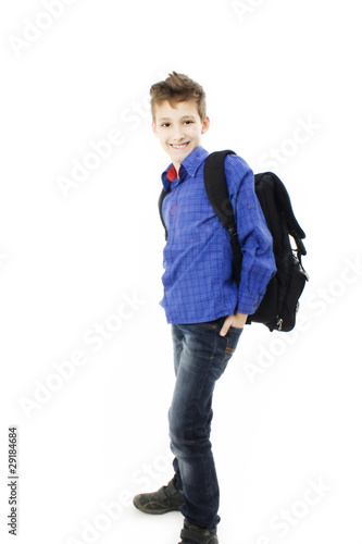 Smiling schoolboy. Isolated over white background