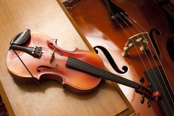 violin on a piano bench
