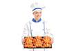 Female baker holding baked croissants