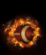 Image of hot burning football on black background