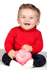 Beautiful blond baby with a piggy-bank