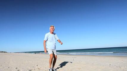 Senior Male Fun Exercise on the Beach