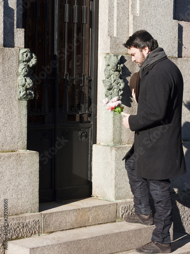 Mourning Man Visiting the Family Vault in a Graveyard