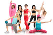 Smiling seven girls group in sportswear does gymnastic exercise