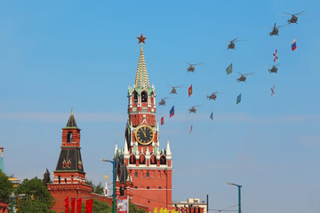 Helicopters with flags fly over Red Square