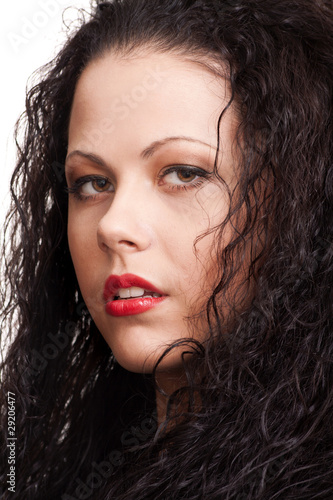 close-up portrait of a beautiful woman with curly hair