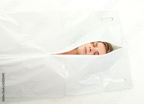 dead young man in bag on deceased
