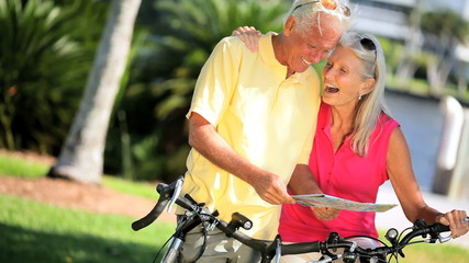 Mature Couple Planning Cycling Trip