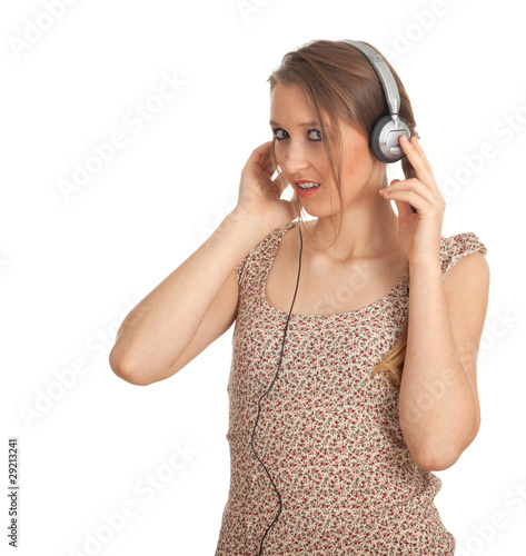 young woman in headphones listening music from mp3