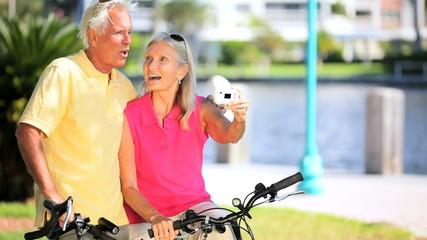 Senior Couple With a Digital Camera