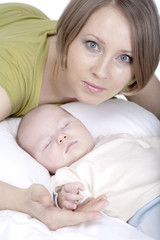 Woman with 2 month baby, Isolated over white background
