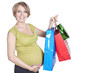 Young pregnant woman shopping while expecting baby