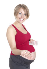 Pregnant woman holding medicine